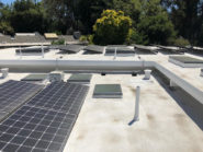 new roof with solar panels and skylights