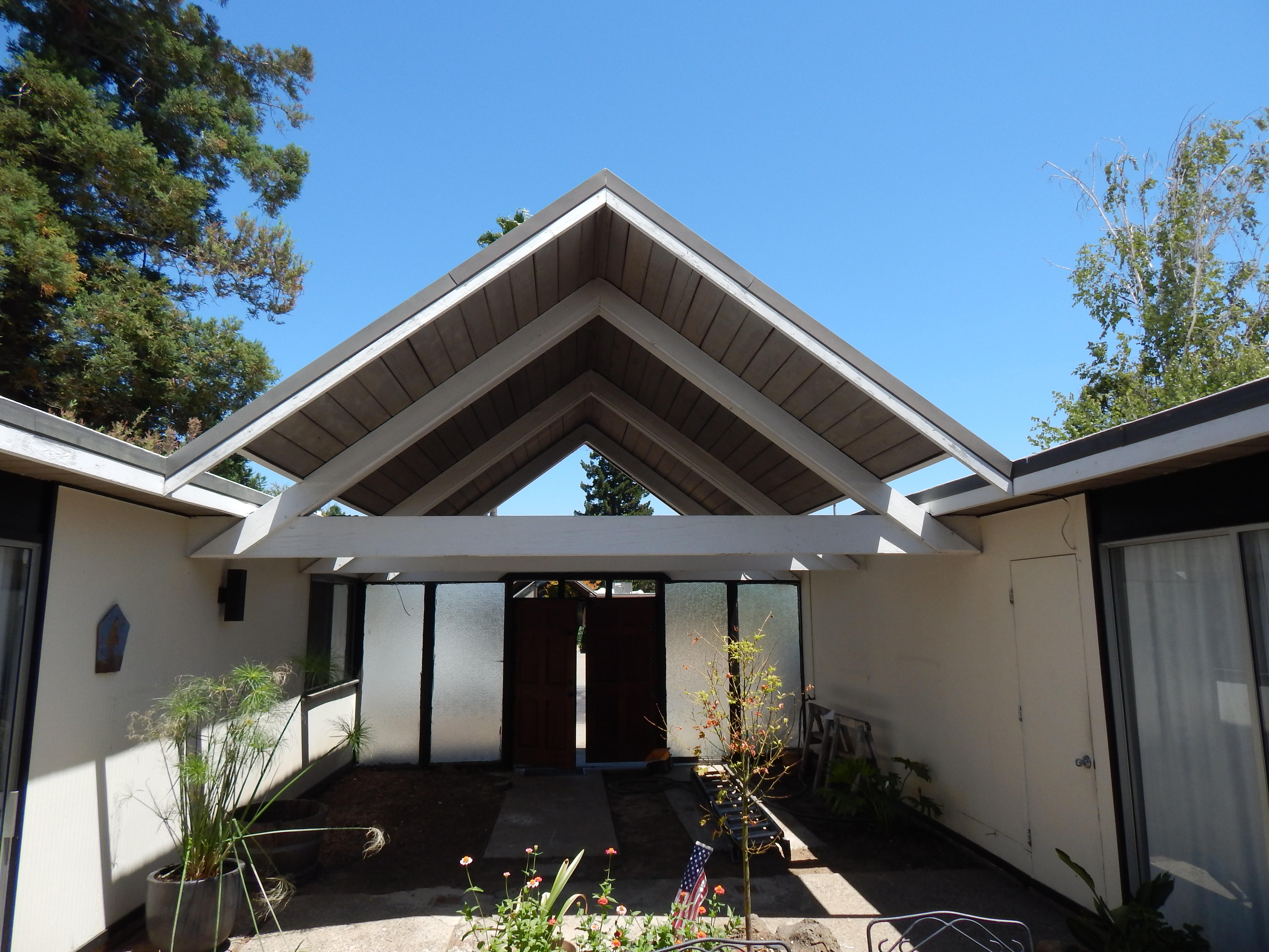 Once House, Two Roofs - Abril Roofing